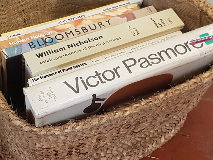 Art text books in a basket.