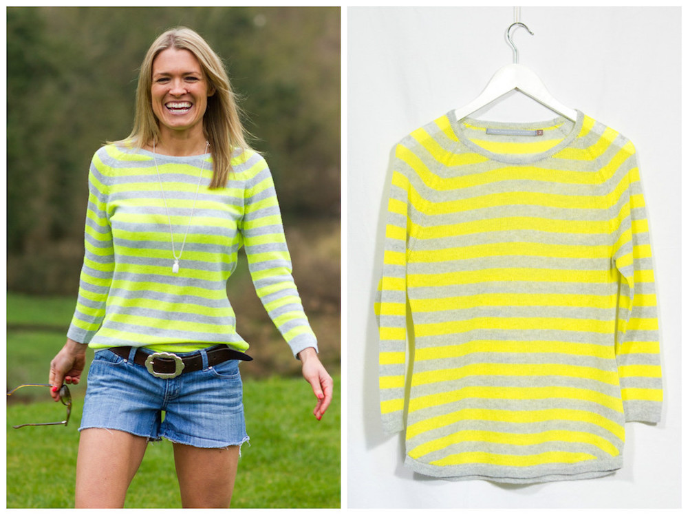 Smiling, blonde woman in boyfriend shorts and a lemon-yellow stripe knit top.