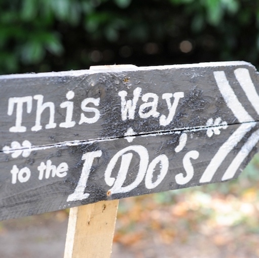 Wooden sign saying This Way To The I Do's