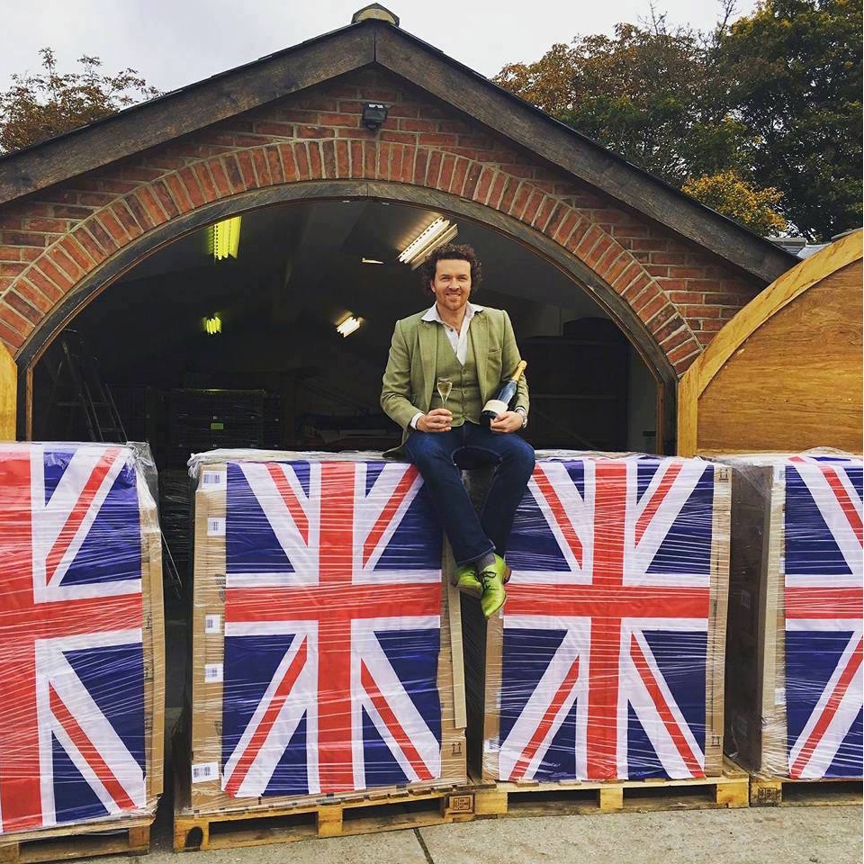 Man sits on Union Jacks with English Sparkling Wine