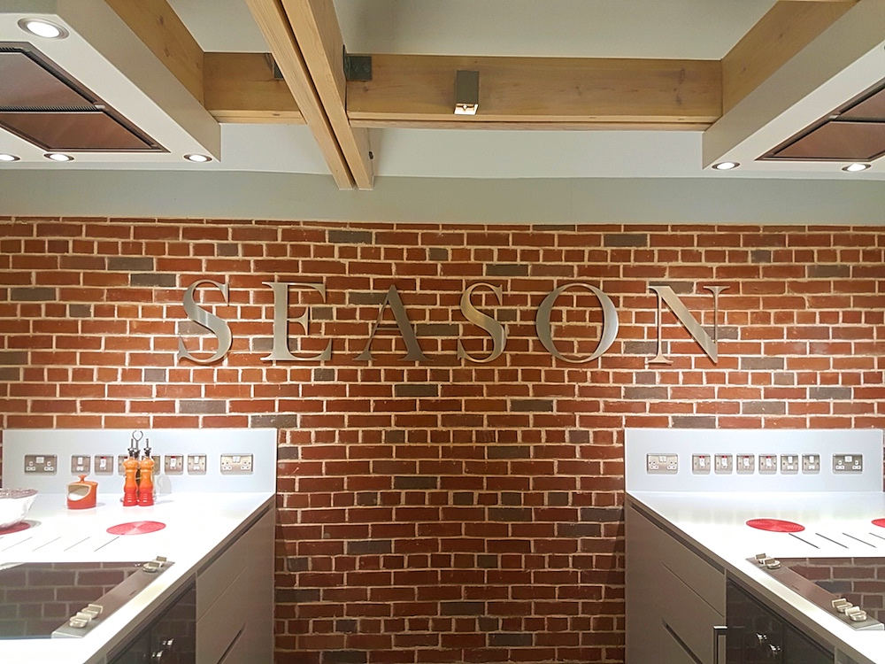 A modern, expose brickwork kitchen.