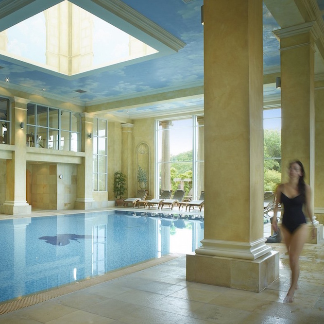 Grecian spa with girl walking in swimsuit.