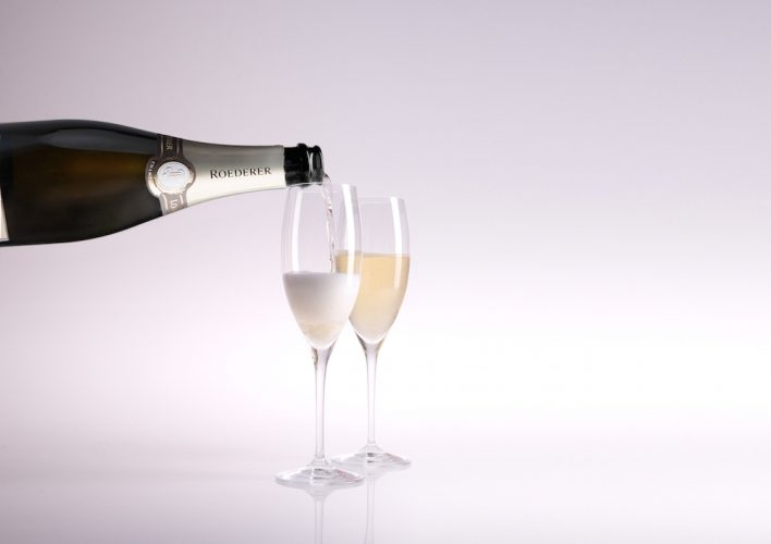 Pouring Champagne into flutes.