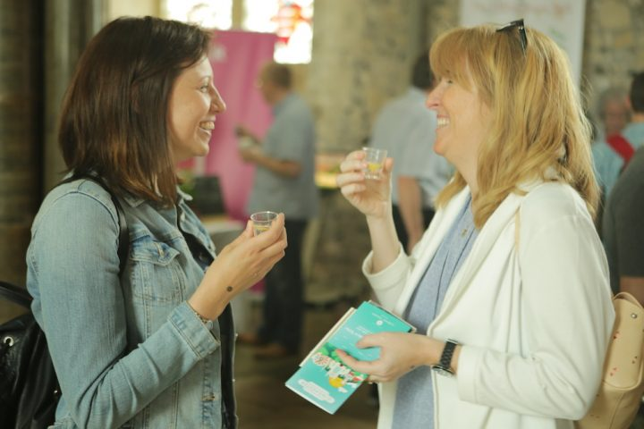 Two women drinking gin and laughing.