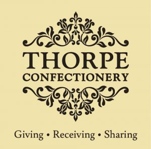 Thorpe Confectionery Logo - Brown with Strapline with Background