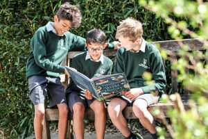 Stroud School children pupils reading book together