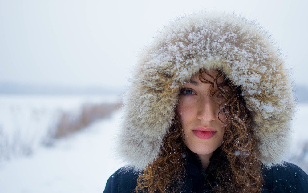 woman in cold weather snow winter beauty skincare tips