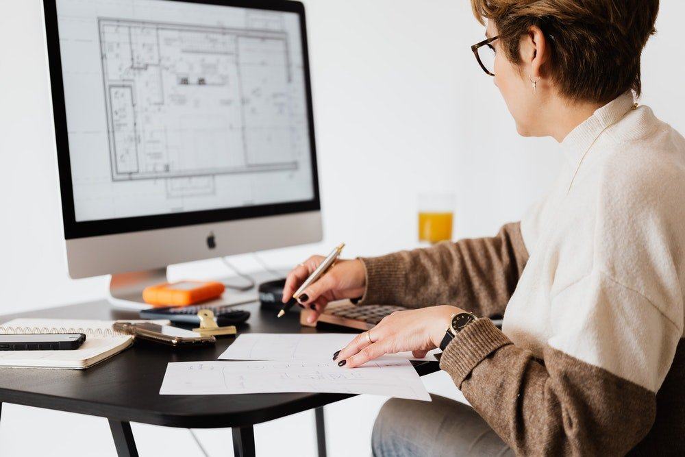 Home renovation woman planning computer plans