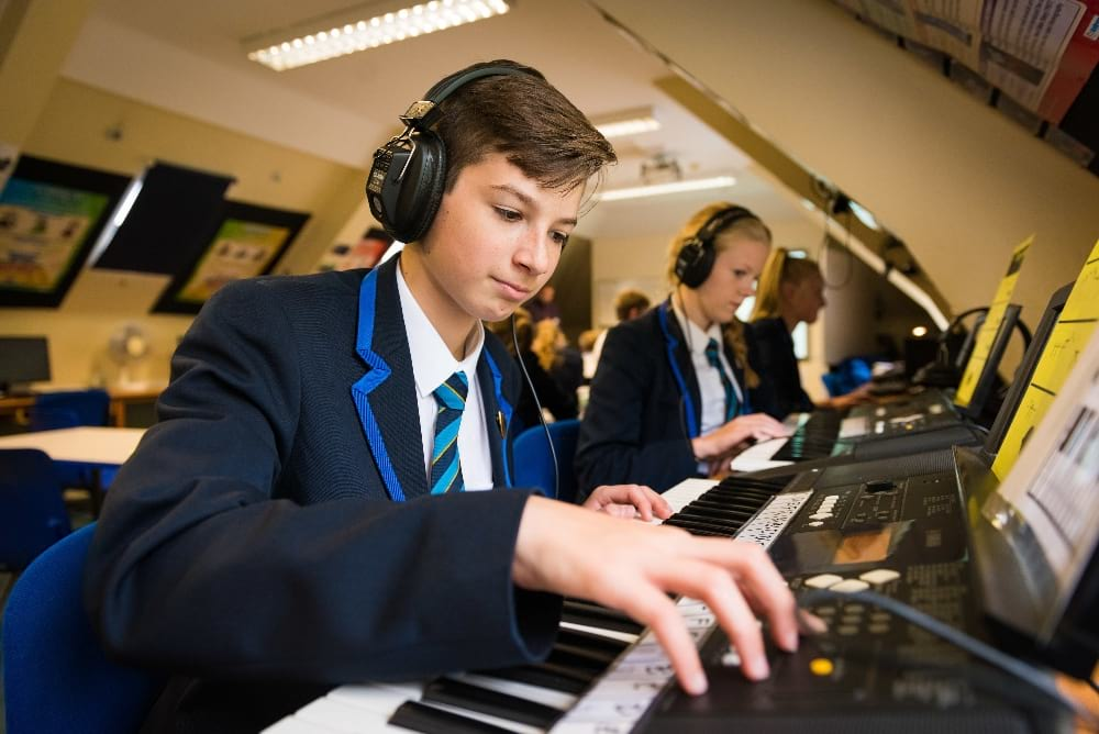 The Gregg School pupils playing keyboards music lesson