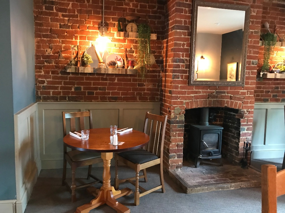 Purefoy Arms pub cosy table by the fire Hampshire